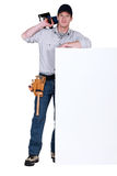 Carpenter stood by message board Royalty Free Stock Photography