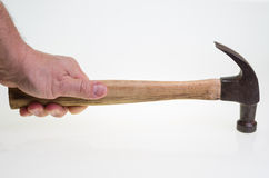 Carpenter swinging a hammer on white Stock Photography