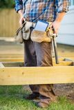 Carpenter With Tablet Computer And Hammer In Tool Stock Photo