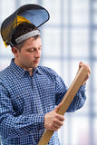 Carpenter take the wooden board Royalty Free Stock Images