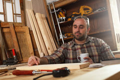 Carpenter taking a coffee break Royalty Free Stock Photography