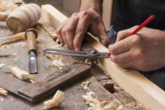 Carpenter taking measurement Royalty Free Stock Images