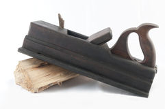 Carpenter tool. Carpenter's tool with a piece of wood on white background Stock Images
