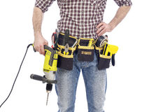 Carpenter with tool belt and drill Stock Image