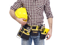 Carpenter with tool belt and hardhat Royalty Free Stock Photography