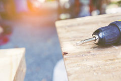 Carpenter tool. Bit of Wireless electric drill  on wooden table,diy at home concept Royalty Free Stock Photography