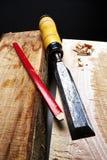 Carpenter Tool. On heavy Wood royalty free stock photos