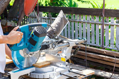 Carpenter tool. Carpenter`s cutting a wooden plate by Circular Saw Stock Photography