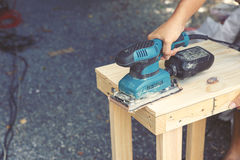 Carpenter tool. Carpenter`s planning a wooden chari by grinder Stock Photos