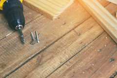 Carpenter tool. Wireless electric drill with screw on wooden table,diy at home concept Royalty Free Stock Photos