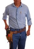 Carpenter in toolbelt holding Stock Photography