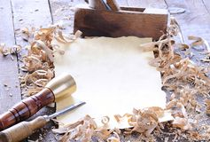 Carpenter tools with blank parchment. Stock Photos