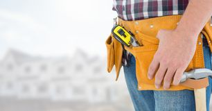 Carpenter with tools on building site Royalty Free Stock Photography
