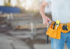 Carpenter with tools on building site Stock Photography
