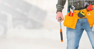 Carpenter with tools on building site Stock Photos