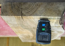 Free Carpenter Tools- Digital Moisture Meter Royalty Free Stock Photography - 84278307