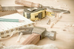 Carpenter tools,hammer,meter,nails,shavings, and chisel. Over wood table royalty free stock photo