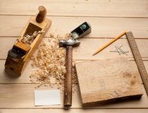 Carpenter tools,hammer,meter, nails,shavings, and Royalty Free Stock Images
