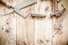 Carpenter tools,hammer,nails,shavings, and chisel on wooden. Royalty Free Stock Image