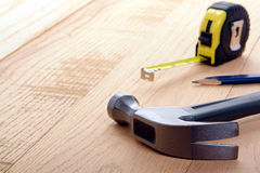 Carpenter Tools Hammer and Tape Measure on Wood Royalty Free Stock Images