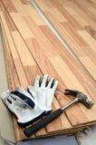 Carpenter tools on new panels floor. Carpenter's hammer and gloves on new designed floor stock images