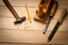 Carpenter tools in pine wood table Royalty Free Stock Photo