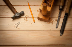 Carpenter tools in pine wood table Stock Images