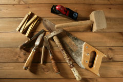 Carpenter tools saw hammer wood tape plane gouge stock photo