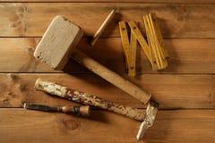 Carpenter tools saw hammer wood tape plane gouge. Carpenter craftman hand tools saw hammer wood tape plane gouge Stock Photography