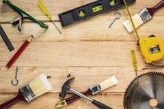 Carpenter tools on wood board Royalty Free Stock Images
