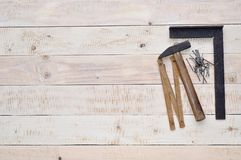 Carpenter tools on wood with space on left Royalty Free Stock Photos