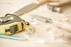 Carpenter tools on wood table Stock Image