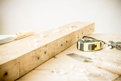 Carpenter tools on wood table Royalty Free Stock Photo