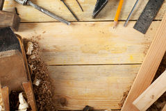 Carpenter tools on wood table background. Copy space. Top view.  royalty free stock image