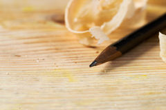 Carpenter tools on wood table background with sawdust. Copy space.  stock image