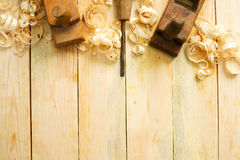 Carpenter tools on wood table background with sawdust. Copy space Stock Photography