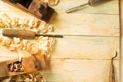 Carpenter tools on wood table background with sawdust. Copy space Stock Photo