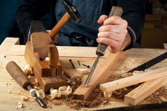 Carpenter tools on wood table background. Top view. Copy space Stock Images
