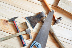 Carpenter tools on wooden boards. Closeup Royalty Free Stock Image