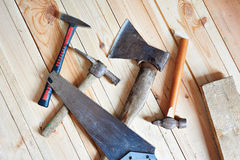 Carpenter tools. On wooden boards closeup Royalty Free Stock Photography