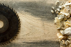 Carpenter tools on wooden table with sawdust. Carpenter workplace top view.  Royalty Free Stock Images