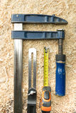 Carpenter tools on wooden table with sawdust. Carpenter workplace top view Stock Photography
