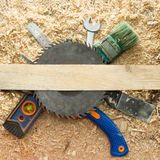 Carpenter tools on wooden table with sawdust. Carpenter workplace top view Royalty Free Stock Photography