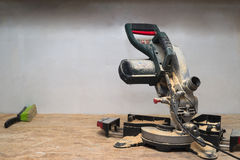 Carpenter tools on wooden table with sawdust. Circular Saw. Copy space Royalty Free Stock Photography
