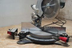 Carpenter tools on wooden table with sawdust. Circular Saw. Copy space stock photography