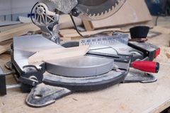 Carpenter tools on wooden table with sawdust. Circular Saw. Royalty Free Stock Photography