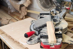 Carpenter tools on wooden table with sawdust. Circular Saw. Royalty Free Stock Image