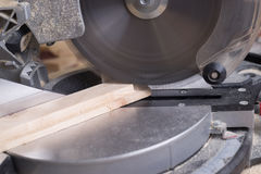 Carpenter tools on wooden table with sawdust. Circular Saw. Stock Photos