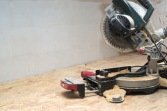 Carpenter tools on wooden table with sawdust. Circular Saw. Royalty Free Stock Photo