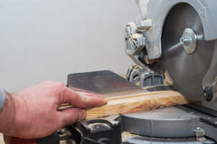 Carpenter tools on wooden table with sawdust. Circular Saw. Royalty Free Stock Images